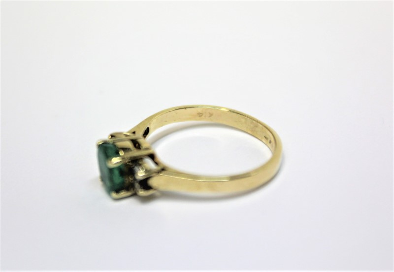Lady's Emerald & Diamond Ring 4 Diamonds .12 CTW 14K Yellow Gold Size: 6.5