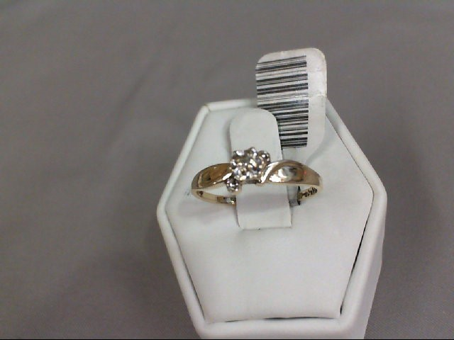 Lady's Diamond Solitaire Ring .01 CT. 10K Yellow Gold 1.48g