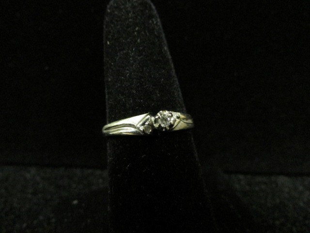 Lady's Diamond Fashion Ring 3 Diamonds 0.04 Carat T.W. 10K White Gold 2.2g