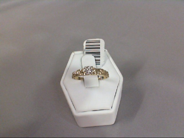 Lady's Diamond Solitaire Ring .01 CT. 10K Yellow Gold 1.73g