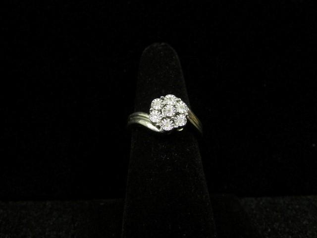 Lady's Silver-Diamond Ring 7 Diamonds .07 Carat T.W. 925 Silver 3.7g Size:7