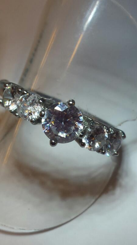 STAINLESS STEEL RING W/ 5 CZ'S SIZE: 9