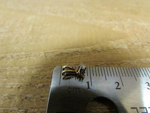 Gold-Diamond Solitaire Pendant .03 CT. 14K Yellow Gold 0.2g