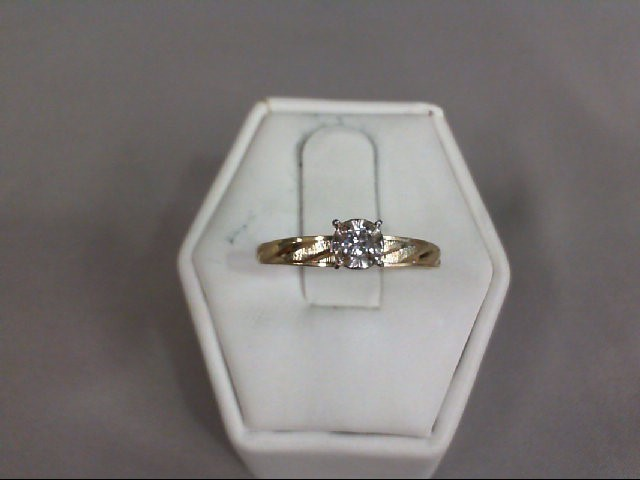 Lady's Diamond Solitaire Ring .07 CT. 14K Yellow Gold 1.19g
