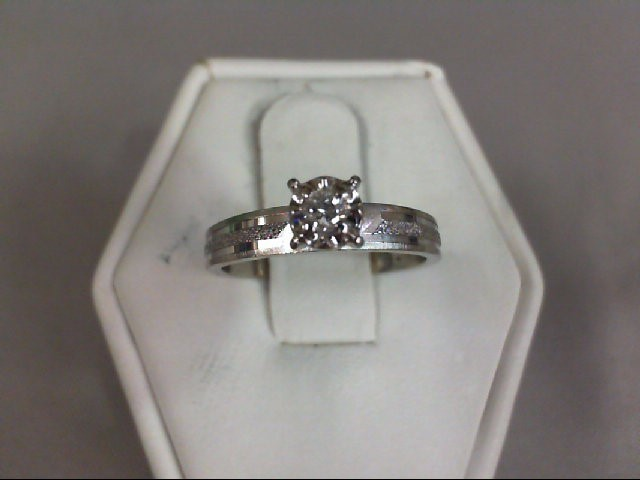 Lady's Diamond Solitaire Ring .05 CT. 10K White Gold 1.75g