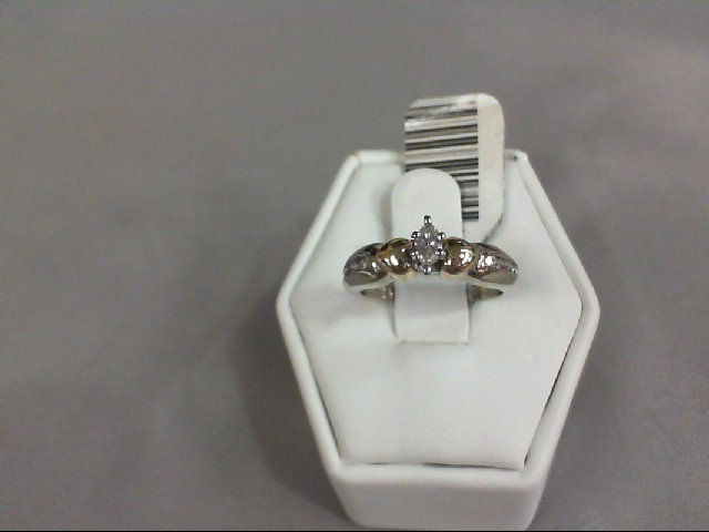 Lady's Diamond Solitaire Ring 7 Diamonds .21 Carat T.W. 10K Yellow Gold 3.05g