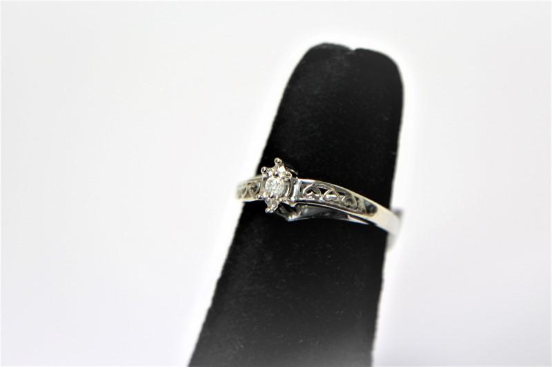 Lady's Diamond Engagement Ring .05 CT. 10K White Gold 2.3g Size:7