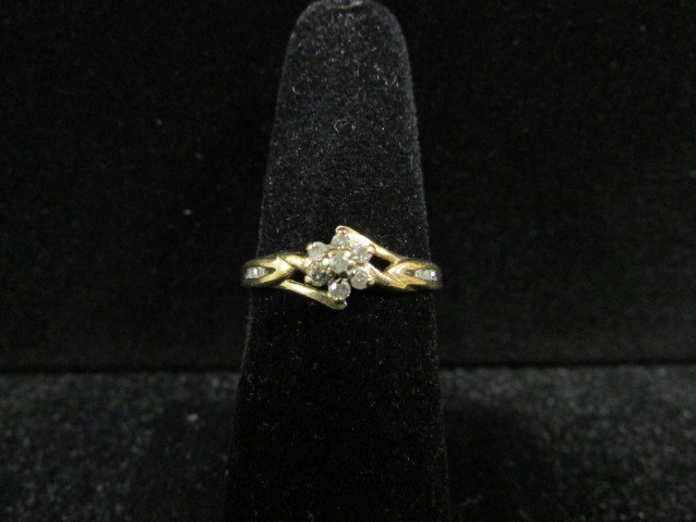Lady's Diamond Fashion Ring 7 Diamonds .14 Carat T.W. 10K Yellow Gold 1.8g
